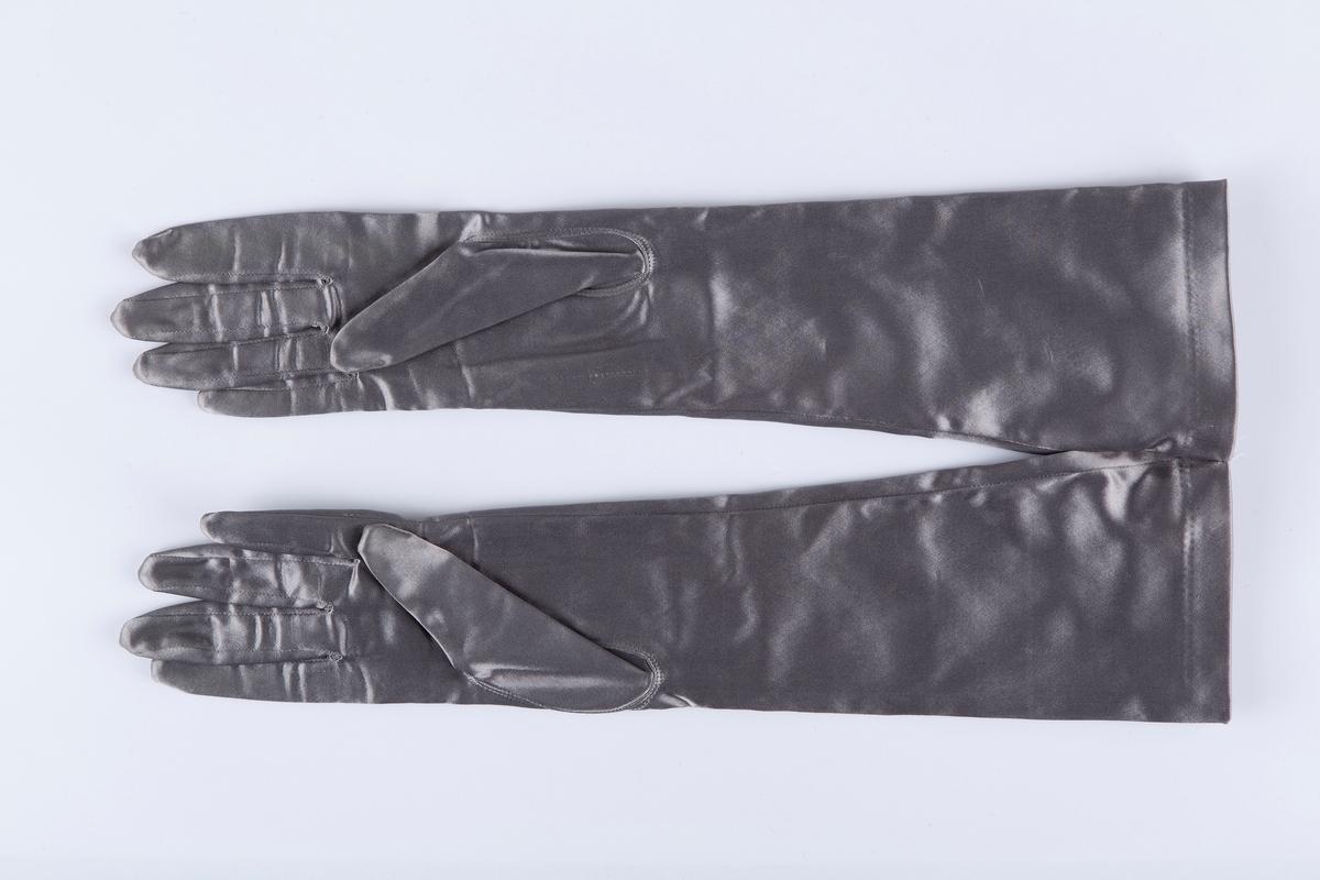 Vanter. Sølvgrått elastisk stoff. Str medium. Lengde til albue.