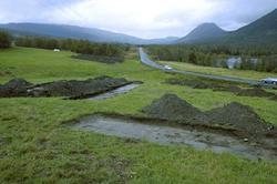 Arkeologiske utgravninger. Mjåvatn. Vegomlegging.