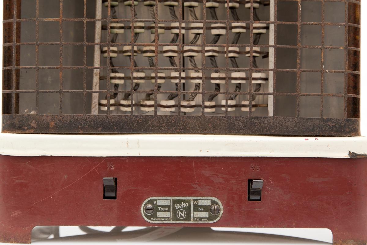 Elektrisk varmeovn i jern, lakkert brun og hvit. Med kabel og støpsel. 2 stk brytere, 1/3, 2/3.