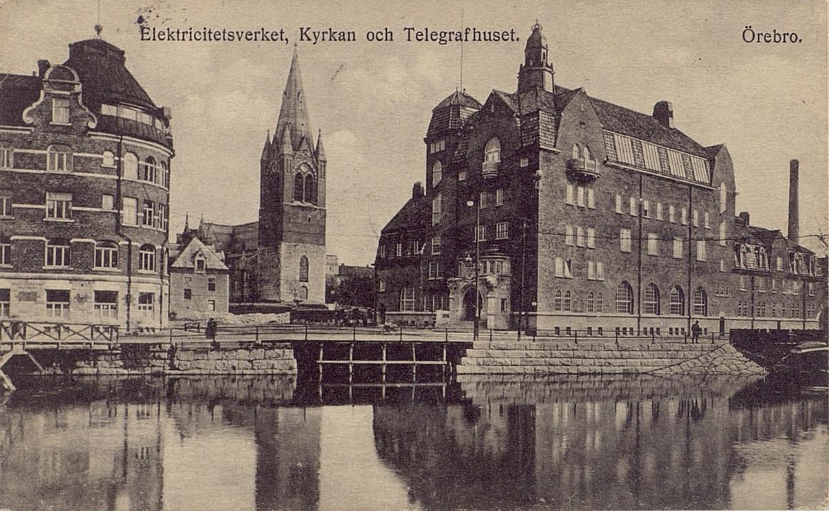 Vykort. Örebro, Elektricitetsverket, Kyrkan och Telegrafhuset.