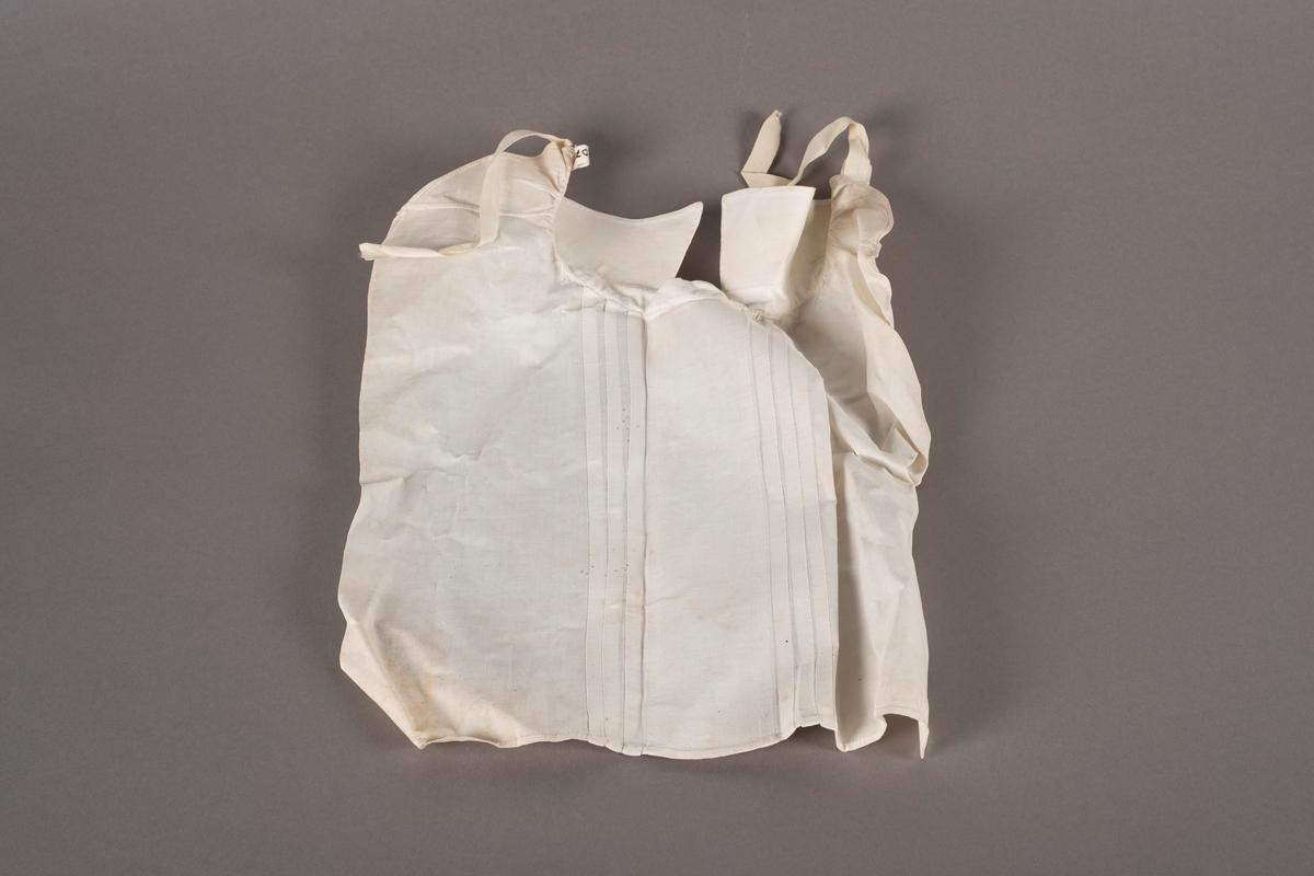 Stivet skjortebryst i bomullslerret. Fastsydd krave og legg i front. To tråder for knytting i nakken.