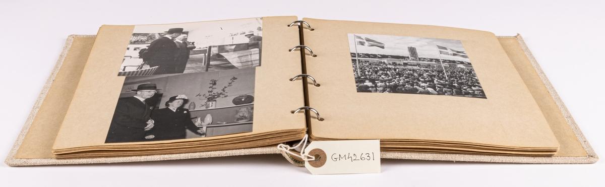Fotoalbum innehållande fotografier från Gävleutställningen1946. Klädd med beige linneväv samt blad i kartong.