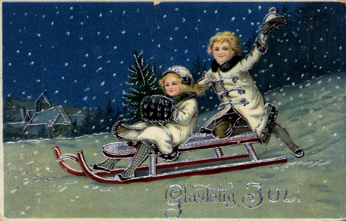 Postkort. Julekort. Julehilsen. Vintermotiv. To barn på kjelke. Tysk kort. Stemplet 22.12.1915.
