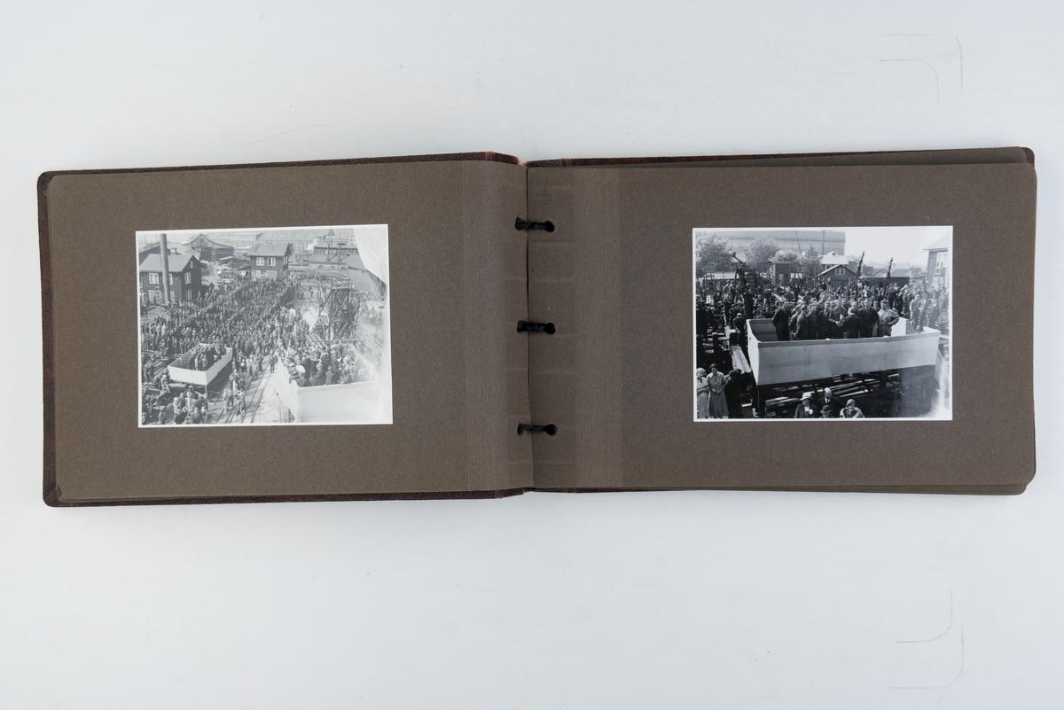 """Album med fotografier av """"British Columbia Express"""" på beddingen og fra sjøsettingen 1936."""