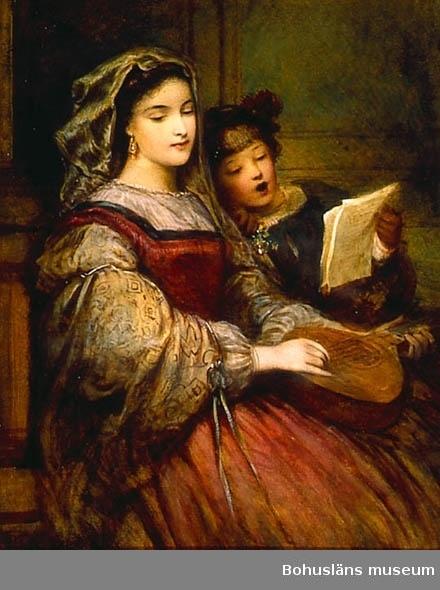 En kvinna ett barn spelar och sjunger tillsammans.