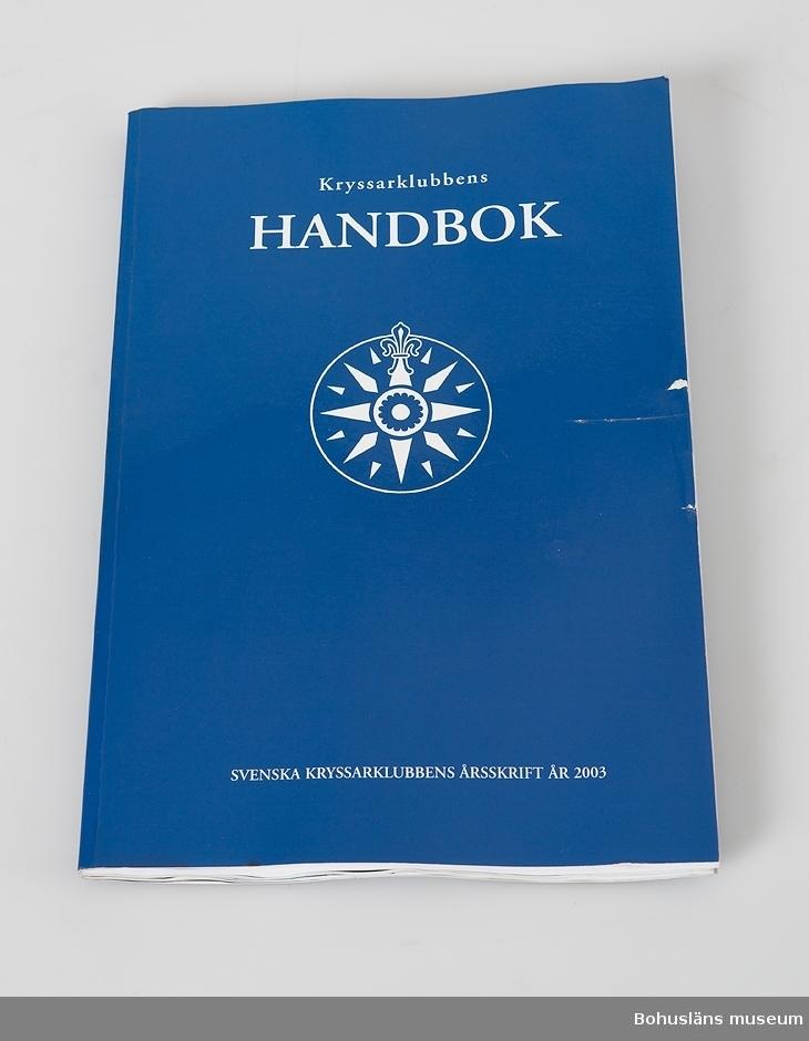 Kryssarklubben handbok, SXK årsskrift 2003. Vattenskadad.