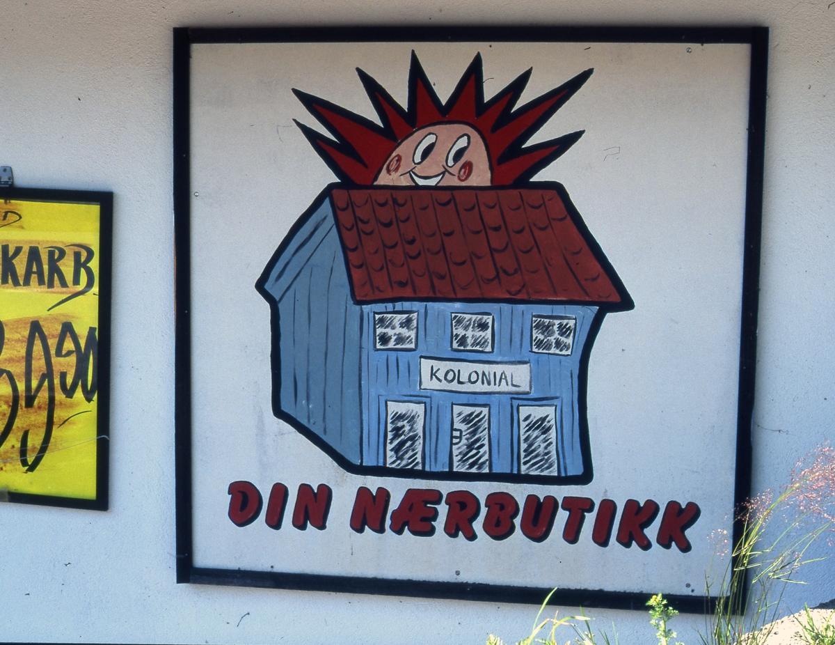"""Hjemmelaget plakat, fra nærbutikk i Risør.  Tekst """"Din nærbutikk""""."""